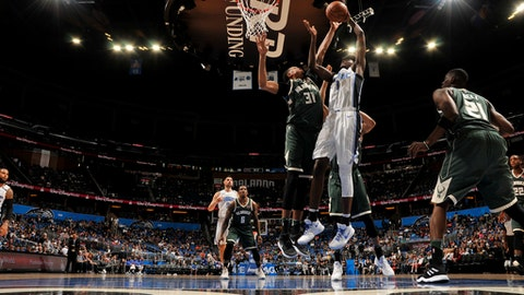ORLANDO, FL - MARCH 14: Jonathan Isaac #1 of the Orlando Magic shoots the ball against the Milwaukee Bucks on March 14, 2018 at Amway Center in Orlando, Florida. (Photo by Fernando Medina/NBAE via Getty Images)