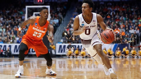 Arizona State's Tra Holder (0) drives past Syracuse's Frank Howard (23) during the first half of a First Four game of the NCAA men's college basketball tournament Wednesday, March 14, 2018, in Dayton, Ohio. (AP Photo/John Minchillo)