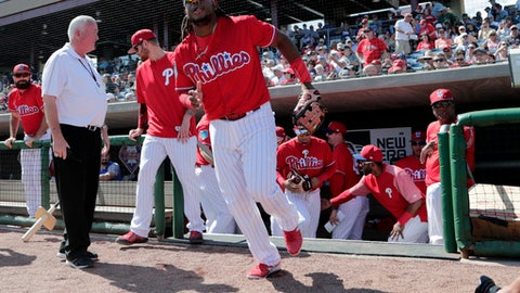 """FILE - In this Feb. 27, 2018, file photo, Philadelphia Phillies third baseman Maikel Franco runs out of the dugout before a baseball spring training game against the Detroit Tigers in Clearwater, Fla. With the emergence of slugger Rhys Hoskins and other young hitters like Aaron Altherr and Nick Williams and the addition of veteran Carlos Santana, Franco won't have to carry the offense. """"Nobody has to be the guy because we have a lineup that can grind you a bit,"""" new manager Gabe Kapler said. """"You're not going to get to the bottom of the lineup without having someone who can do home-run damage."""" (AP Photo/Lynne Sladky, File)"""
