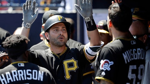 Pittsburgh Pirates' Francisco Cervelli celebrates with Josh Harrison (5) and Joe Musgrove (59) after hitting a two-run home run off New York Yankees starting pitcher Sonny Gray during the first inning of a spring training baseball game Thursday, March 15, 2018, in Tampa, Fla. (AP Photo/Chris O'Meara)