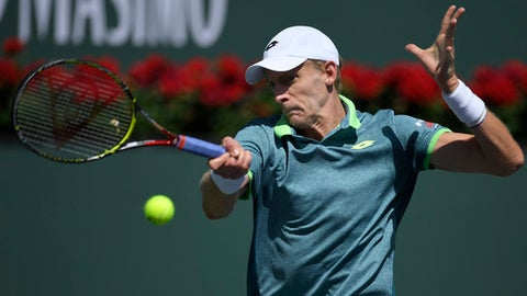 Kevin Anderson, of South Africa, returns a shots against Borna Coric, of Croatia, during the quarterfinals at the BNP Paribas Open tennis tournament, Thursday, March 15, 2018, in Indian Wells, Calif. (AP Photo/Mark J. Terrill)