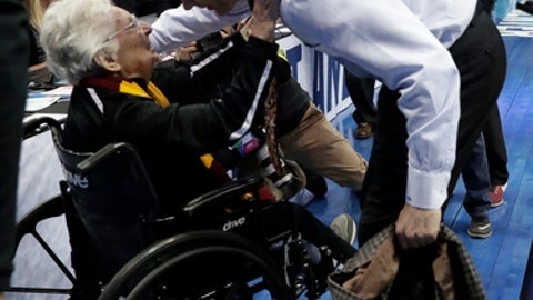 Sister Jean Dolores Schmidt, left, greets Loyola-Chicago coach Porter Moser as he walks off the court after the team's first-round game against Miami at the NCAA men's college basketball tournament in Dallas, Thursday, March 15, 2018. (AP Photo/Tony Gutierrez)