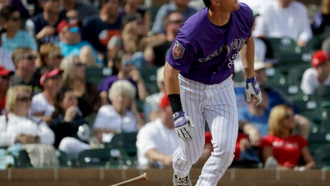 Colorado Rockies' DJ LeMahieu watches his grand slam against the Los Angeles Angels during the fourth inning of a spring baseball game in Scottsdale, Ariz., Thursday, March 15, 2018. (AP Photo/Chris Carlson)