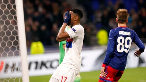 Lyon's Myziane Maolida reacts after he missed a goal during the Europa League, round of 16 second leg soccer match between Lyon and CSKA Moscow in Decines, near Lyon, central France, Thursday March 15, 2018. (AP Photo/Laurent Cipriani)