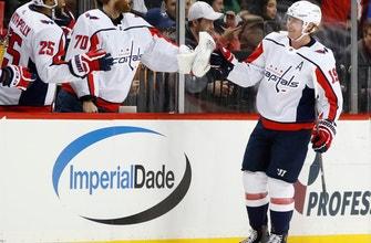 Oshie scores 2 to help Capitals beat Islanders 7-3