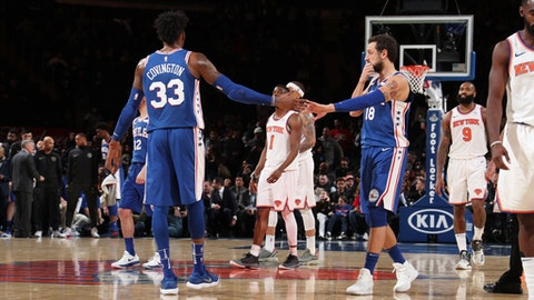 NEW YORK, NY - MARCH 15:  Robert Covington #33 and Marco Belinelli #18 of the Philadelphia 76ers exchange high fives during the game against the New York Knicks on March 15, 2018 at Madison Square Garden in New York City, New York.  (Photo by Nathaniel S. Butler/NBAE via Getty Images)