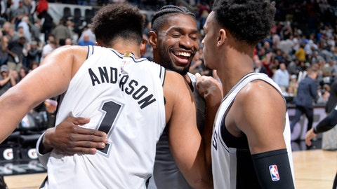 SAN ANTONIO, TX - MARCH 15:  Kyle Anderson #1 of the San Antonio Spurs hugs Brandon Paul #3 of the San Antonio Spurs after the game against the New Orleans Pelicanson March 15, 2018 at the AT&T Center in San Antonio, Texas.