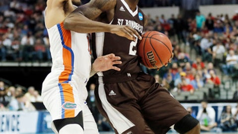 St. Bonaventure guard Matt Mobley (2) battles Florida guard Chris Chiozza (11) for space during the first half of a first-round game at the NCAA college basketball tournament in Dallas, Thursday, March 15, 2018. (AP Photo/Brandon Wade)