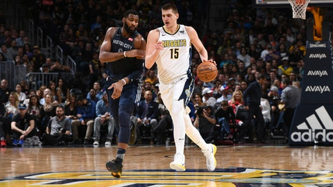 DENVER, CO - MARCH 15: Nikola Jokic #15 of the Denver Nuggets handles the ball against the Detroit Pistons on March 15, 2018 at the Pepsi Center in Denver, Colorado. (Photo by Garrett Ellwood/NBAE via Getty Images)