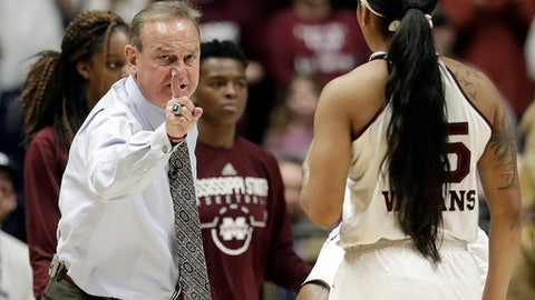 FILE - In this March 4, 2018, file photo, Mississippi State head coach Vic Schaefer, left, talks to guard Victoria Vivians (35) during the second half of an NCAA college basketball game against South Carolina in the championship of the Southeastern Conference tournament in Nashville, Tenn. Top seed Mississippi State is a big favorite to break through its regional and make it to the Sweet 16 for a third straight season.  (AP Photo/Mark Humphrey, File)