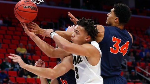 Purdue guard Carsen Edwards (3) and Cal State Fullerton forward Jackson Rowe (34) battle for a rebound during the first half of an NCAA men's college basketball tournament first-round game in Detroit, Friday, March 16, 2018. (AP Photo/Paul Sancya)