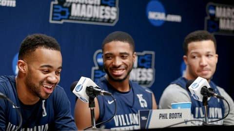Villanova's Jalen Brunson, right, Mikal Bridges, center, and Phil Booth, left, chuckle as they take questions during a news conference at the NCAA men's college basketball tournament, Friday, March 16, 2018, in Pittsburgh. Villanova faces Alabama in a second-round game on Saturday. (AP Photo/Keith Srakocic)