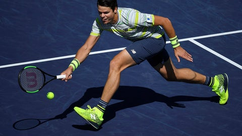 Milos Raonic, of Canada, returns a shot against Sam Querrey during the quarterfinals of the BNP Paribas Open tennis tournament, Friday, March 16, 2018, in Indian Wells, Calif. (AP Photo/Mark J. Terrill)