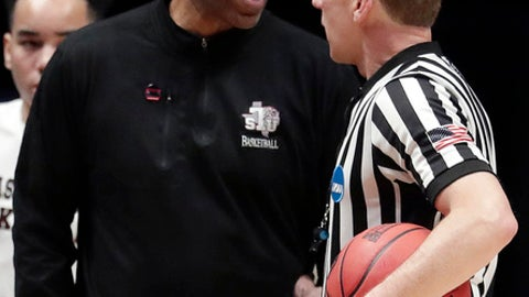 Texas Southern head coach Mike Davis challenges an official in the first half of a first-round game against Xavier in the NCAA college basketball tournament in Nashville, Tenn., Friday, March 16, 2018. (AP Photo/Mark Humphrey)
