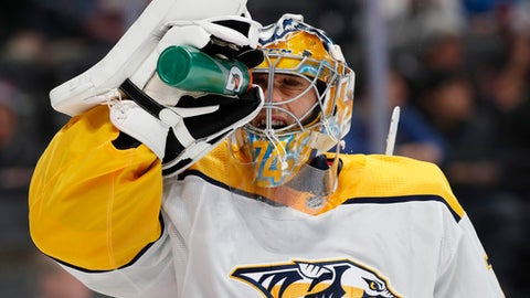 Nashville Predators goaltender Juuse Saros sprays water onto his face during a timeout in the first period of the team's NHL hockey game against the Colorado Avalanche on Friday, March 16, 2018, in Denver. (AP Photo/David Zalubowski)