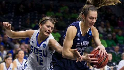 Villanova's Kelly Jekot (25) grabs the ball next to South Dakota State's MacyMiller (12) during a first-round game in the NCAA women's college basketball tournament Friday, March 16, 2018, in South Bend, Ind. (AP Photo/Robert Franklin)