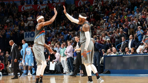 OKLAHOMA CITY, OK- MARCH 16:  Corey Brewer #3 and Carmelo Anthony #7 of the Oklahoma City Thunder exchange a high five during the game against the LA Clippers on March 16, 2018 at Chesapeake Energy Arena in Oklahoma City, Oklahoma. (Photo by Layne Murdoch Sr./NBAE via Getty Images)