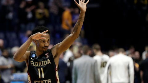 Florida State guard Braian Angola (11) reacts in the second half of a first-round game against Missouri in the NCAA college basketball tournament in Nashville, Tenn., Friday, March 16, 2018. Florida State won 67-54. (AP Photo/Mark Humphrey)