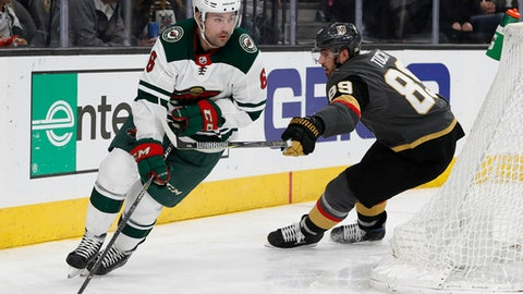 Minnesota Wild defenseman Ryan Murphy (6) skates round Vegas Golden Knights right wing Alex Tuch during the third period of an NHL hockey game Friday, March 16, 2018, in Las Vegas. The Wild won 4-2. (AP Photo/John Locher)