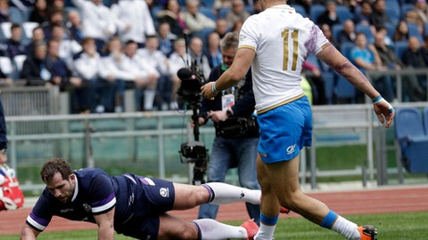 Scotland's Fraser Brown scores a try as Italy's Mattia Bellini looks on during the Six Nations rugby union match between Italy and Scotland at Rome's Olympic stadium, Saturday, March 17, 2018. (AP Photo/Andrew Medichini)