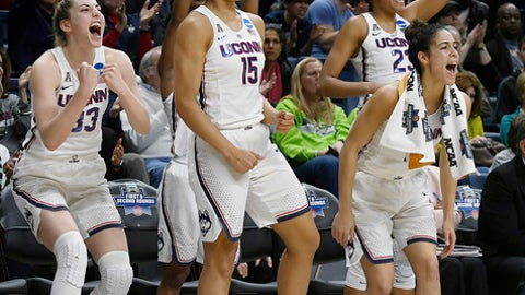 Connecticut's Katie Lou Samuelson (33), Gabby Williams (15), Kia Nurse (11), and Azur Stevens (23) react on the sideline during the second half of a first-round game against Saint Francis (Pa.) in the NCAA women's college basketball tournament in in Storrs, Conn., Saturday, March 17, 2018. UConn won 140-52. (AP Photo/Jessica Hill)