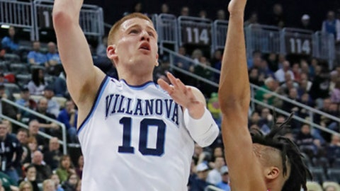 Villanova 's Donte DiVincenzo (10) goes up for a shot over Alabama 's Dazon Ingram (12) during the first half of an NCAA men's college basketball tournament second-round game, in Pittsburgh, Saturday, March 17, 2018. (AP Photo/Gene J. Puskar)