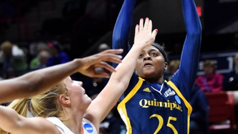 Quinnipiac's Aryn McClure (25) shoots over Miami's Leah Purvis (21) during a first-round game in the NCAA women's college basketball tournament in Storrs, Conn., Saturday, March 17, 2018. (AP Photo/Stephen Dunn)