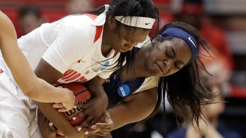 Ohio State's Linnae Harper, left, and George Washington's Neila Luma battle for the ball in the first half during a first-round game in the NCAA women's college basketball tournament Saturday, March 17, 2018, in Columbus, Ohio. (AP Photo/Tony Dejak)