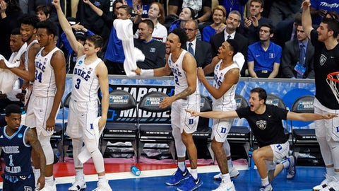 Duke players celebrate a three-point shot as time runs out in the second half of an NCAA men's college basketball tournament second-round game against Rhode Island, in Pittsburgh, Saturday, March 17, 2018. Duke won 87-62. (AP Photo/Gene J. Puskar)