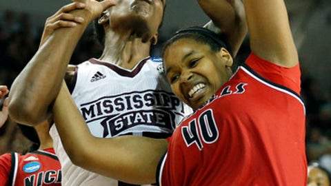 Mississippi State center Teaira McCowan, left, struggles with Nicholls center Marina Lilly, right, to control the basketball during the first half of a first-round game in the NCAA women's college basketball tournament in Starkville, Miss., Saturday, March 17, 2018. (AP Photo/Rogelio V. Solis)