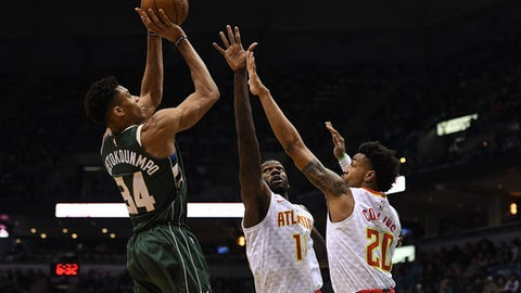MILWAUKEE, WI - MARCH 17:  Giannis Antetokounmpo #34 of the Milwaukee Bucks shoots over Dewayne Dedmon #14 and John Collins #20 of the Atlanta Hawks during the second half of a game at the Bradley Center on March 17, 2018 in Milwaukee, Wisconsin.  (Photo by Stacy Revere/Getty Images)