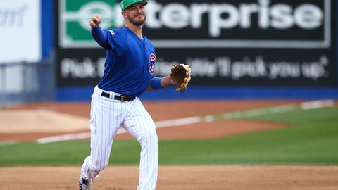 Chicago Cubs third baseman Kris Bryant throws to first base during the team's exhibition baseball game against the Cleveland Indians in Las Vegas on Saturday, March 17, 2018. (Chase Stevens/Las Vegas Review-Journal via AP)