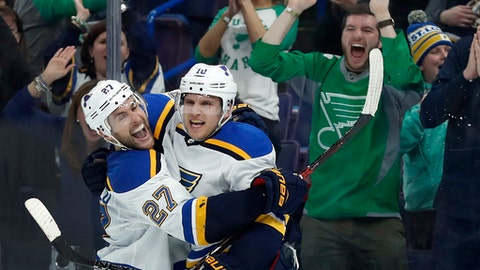 St. Louis Blues' Brayden Schenn is congratulated by Alex Pietrangelo, left, after scoring the game-winning goal in overtime of an NHL hockey game against the New York Rangers Saturday, March 17, 2018, in St. Louis. The Blues won 4-3. (AP Photo/Jeff Roberson)
