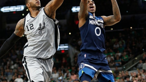 SAN ANTONIO,TX - MARCH 17 : LaMarcus Aldridge #12 of the San Antonio Spurs blocks shot attempt of Jeff Teague #0 of the Minnesota Timberwolves  at AT&T Center on March 17, 2018  in San Antonio, Texas.  (Photo by Ronald Cortes/Getty Images)