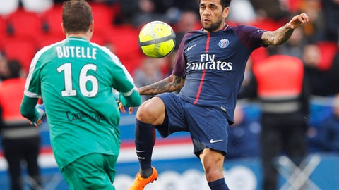 FILE - In this Wednesday, March 14, 2018 file photo, PSG's Dani Alves, right, vies for the ball with Angers' Ludovic Butelle during the French League One soccer match between Paris Saint-Germain and Angers at the Parc des Princes Stadium, in Paris, France. Alves took Paris Saint-Germain a step closer to the French title on Sunday, March 18, 2018 scoring his first league goal of the season with a late header as PSG won 2-1 at Nice.  (AP Photo/Christophe Ena, File )
