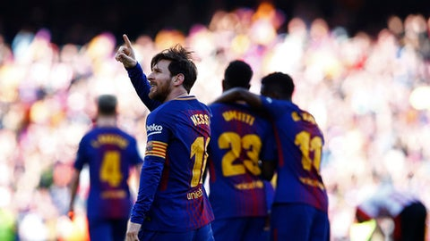 FC Barcelona's Lionel Messi, left, celebrates after scoring during the Spanish La Liga soccer match between FC Barcelona and Athletic Bilbao at the Camp Nou stadium in Barcelona, Spain, Sunday, March 18, 2018. (AP Photo/Manu Fernandez)