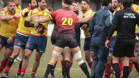 Spain's players, left, clash with Romania referee Vlad Iordachescu, after the Rugby Europe Championship match between Belgium and Spain at the Little Heysel Stadium in Brussels, Sunday, March 18, 2018. (AP Photo/Olivier Matthys)
