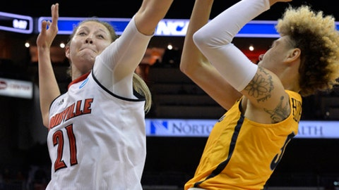 Louisville forward Kylee Shook (21) attempts to block the shot of Marquette guard Natisha Hiedeman (5) during the first half of a second-round game in the NCAA women's college basketball tournament in Louisville, Ky., Sunday, March 18, 2018. (AP Photo/Timothy D. Easley)