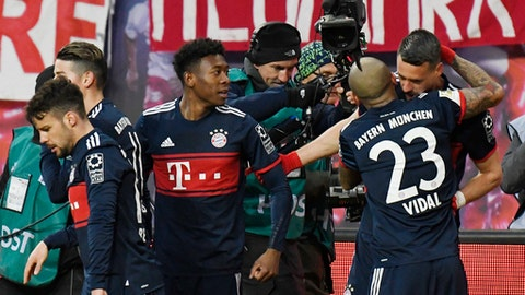 Bayern's Sandro Wagner, right, celebrates together with his teammates after scoring a goal during the German first division Bundesliga soccer match between RB Leipzig and Bayern Munich in Leipzig, Germany, Sunday, March 18, 2018. (AP Photo/Jens Meyer)