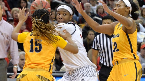 Louisville forward Myisha Hines-Allen (2) looks for help while trapped bt the defense of Marquette guard Amani Wilborn (15) and forward Erika Davenport (12) during the second half of a second-round game in the NCAA women's college basketball tournament in Louisville, Ky., Sunday, March 18, 2018. (AP Photo/Timothy D. Easley)