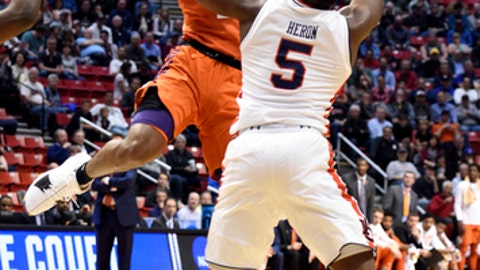 Clemson guard Marcquise Reed passes the ball as Auburn guard Mustapha Heron (5) defends during the first half of a second-round NCAA college basketball tournament game Sunday, March 18, 2018, in San Diego. (AP Photo/Denis Poroy)
