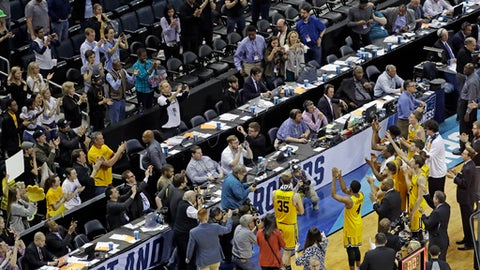 UMBC players salute their fans after losing 50-43 to Kansas State a second-round game in the NCAA men's college basketball tournament in Charlotte, N.C., Sunday, March 18, 2018. (AP Photo/Chuck Burton)