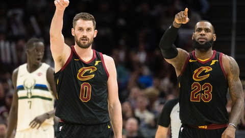 CLEVELAND, OH - MARCH 19: Kevin Love #0 and LeBron James #23 of the Cleveland Cavaliers celebrate after a teammate scored during the second half against the Milwaukee Bucks at Quicken Loans Arena on March 19, 2018 in Cleveland, Ohio. The Cavaliers defeated the Bucks 124-117. (Photo by Jason Miller/Getty Images)