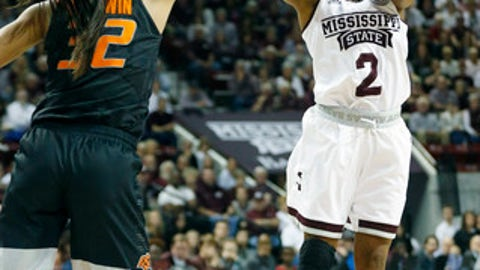 Mississippi State guard Morgan William (2) takes a shot against Oklahoma State guard Loryn Goodwin (32) during the first half of a round-two game in the NCAA women's college basketball tournament in Starkville, Miss., Monday, March 19, 2018. (AP Photo/Rogelio V. Solis)