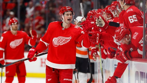 Detroit Red Wings center Dylan Larkin (71) celebrates his goal against the Philadelphia Flyers during the third period of an NHL hockey game Tuesday, March 20, 2018, in Detroit. (AP Photo/Paul Sancya)