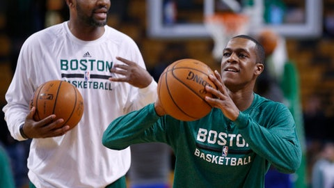 Boston Celtics guard Rajon Rondo, right, shoots during pre-game warm-ups as assistant coach Walter McCarty watches prior to an NBA basketball game against the Los Angeles Clippers in Boston, Wednesday, Dec. 11, 2013. Rondo has been sidelined all season with a knee injury. (AP Photo/Elise Amendola)