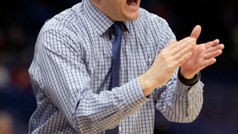 "FILE - In this March 2, 2018, file photo, Drake head coach Niko Medved reacts during the first half of an NCAA college basketball game against Bradley in the quarterfinals of the Missouri Valley Conference tournament in St. Louis. Medved, a former Colorado State assistant coach, is returning to Fort Collins to lead the Rams men's basketball program after spending a year as Drake's head coach. Medved replaces Larry Eustachy, who stepped down last month, ending a ""climate assessment"" of the program led by athletic director Joe Parker. (AP Photo/Tom Gannam, File)"