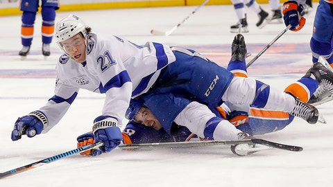Tampa Bay Lightning center Brayden Point (21) hits the ice on a breakaway as he is tripped by New York Islanders defenseman Adam Pelech (50) during the first period of an NHL hockey game Thursday, March 22, 2018, in New York. (AP Photo/Julie Jacobson)