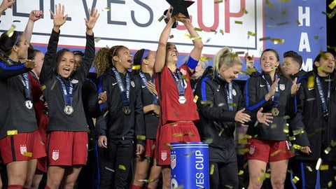 FILE - In this Wednesday, March 7, 2018 file photo, United States midfielder Carli Lloyd, center, lifts the championship trophy with teammates after defeating England 1-0, to win the SheBelieves Cup women's soccer tournament in Orlando, Fla. The United States stays top of the FIFA womens world rankings after winning the SheBelieves Cup, and England goes above Germany into second. The Americans went unbeaten through the four-team round-robin tournament it hosted this month. (AP Photo/Phelan M. Ebenhack, File)