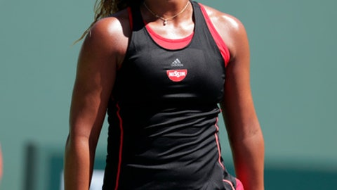 Naomi Osaka, of Japan, reacts after missing a point against Elina Svitolina, of Ukraine, during the Miami Open tennis tournament, Friday, March 23, 2018, in Key Biscayne, Fla. (AP Photo/Lynne Sladky)